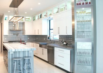 Stainless steel kitchen with white cabinets